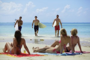 bigstock-Surfers-walking-up-the-beach-w-42082153